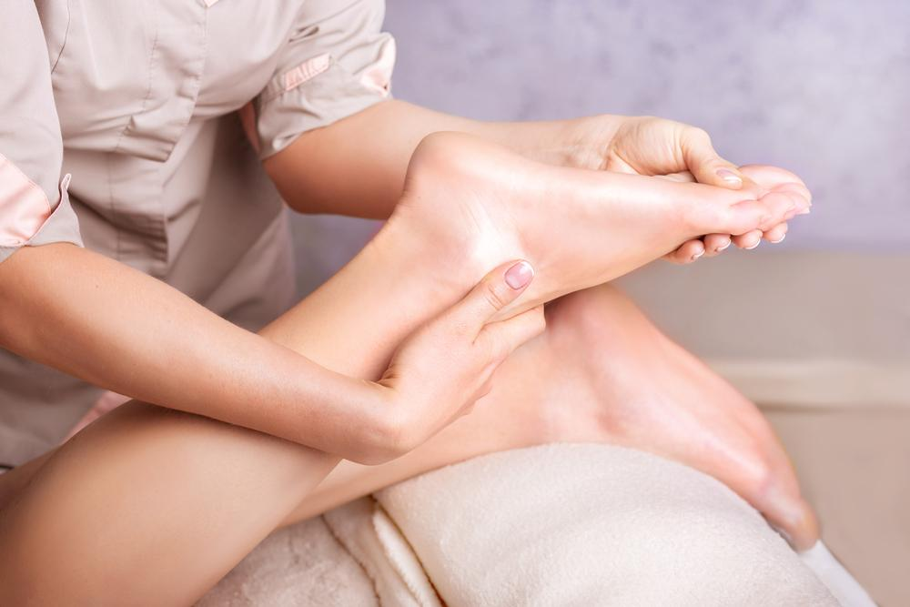 woman massaging feet
